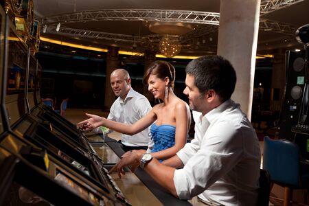 slot machines: gambling woman showing friends slot machine
