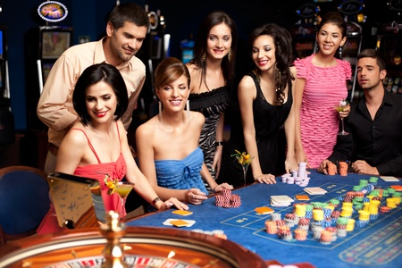 casino table: anxious adults waiting for roulette results