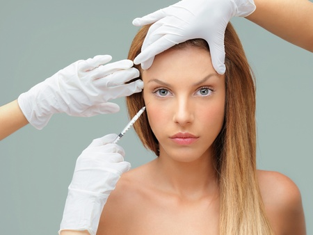 botox: beautiful young woman botox injection eye area