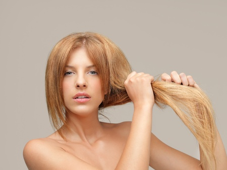 young woman pulling damaged hair both hands Stock Photo - 10918441