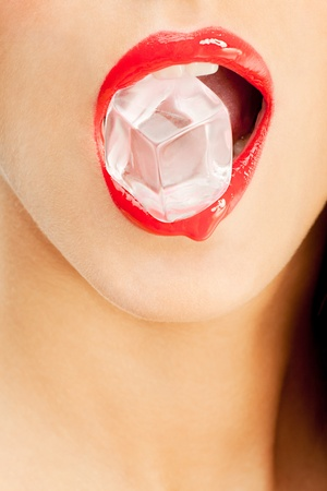 woman red lips detail biting ice cube  Stock Photo - 10705463