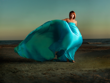 young woman beach turqouise dress wind blowing Stock Photo - 10918557