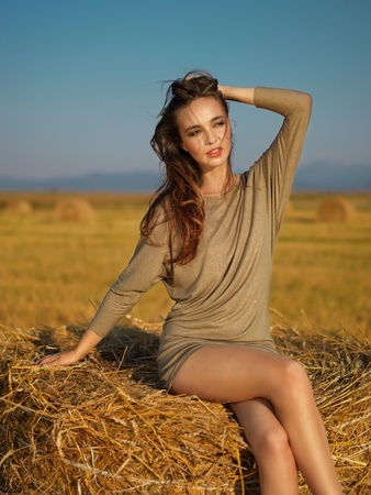 beautiful woman hay stack hand in hair photo