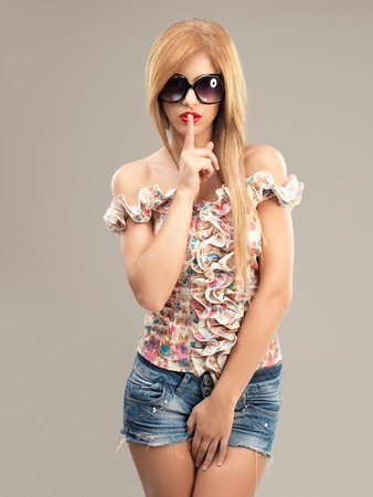 sexy shorts: sexy blonde woman with sunglasses and jeans shorts posing at camera