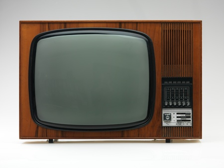 frontal view: vintage black and white tv on white background, frontal view