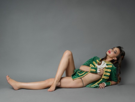 young  cuffs: studio fashion portrait of young woman in vintage outfit, laying down, posing at camera
