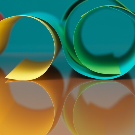background macro image of colored origami pattern made of curved sheets of paper, with mirror reflexions photo