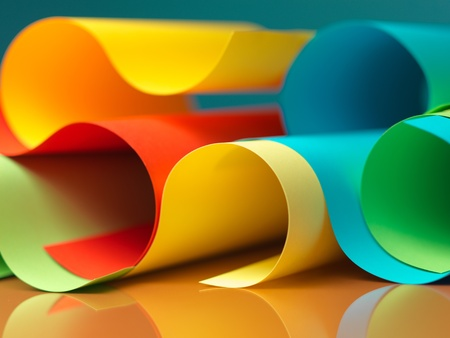 graphic abstract image of colorful origami pattern made of curved sheets of paper photo