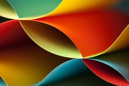 asymmetry: graphic abstract image of colorful origami pattern made of curved sheets of paper