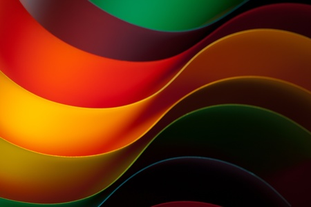 Imagen macro de coloridas láminas curvadas de papel con forma de abanico, sobre fondo naranja Foto de archivo - 11986267