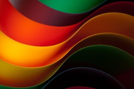 Macro foto van kleurrijke gebogen vellen papier de vorm van een ventilator, op oranje achtergrond Stockfoto - 11986267