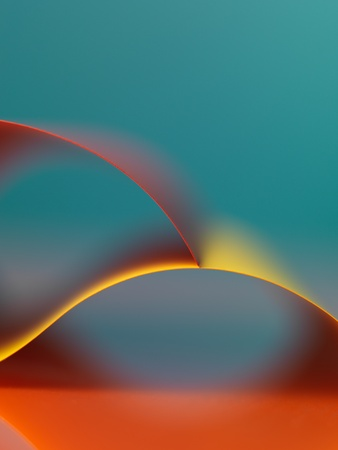 graphic macro image of colorful origami pattern made of curved sheets of paper photo