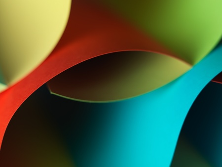 graphic macro image of colorful origami pattern made of curved sheets of paper