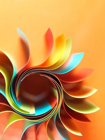 오렌지 배경에 꽃 모양의 종이의 화려한 곡선 시트의 매크로 이미지