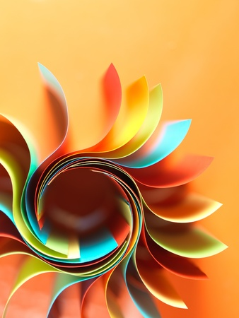tvůrčí: makro snímek barevných zakřivených listů papíru ve tvaru květu, na oranžovém pozadí