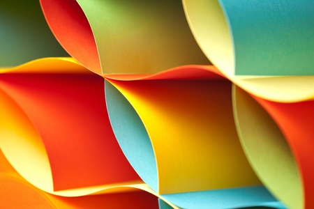 asymmetry: detail background macro image of colorful origami pattern made of curved sheets of paper