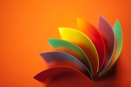 orange background: background image of colorful origami fan pattern made of curved sheets of paper, on orange background