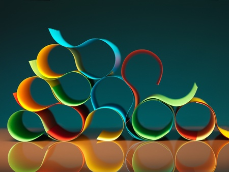 background image of colorful origami pattern made of curved sheets of paper, with mirror reflexion photo