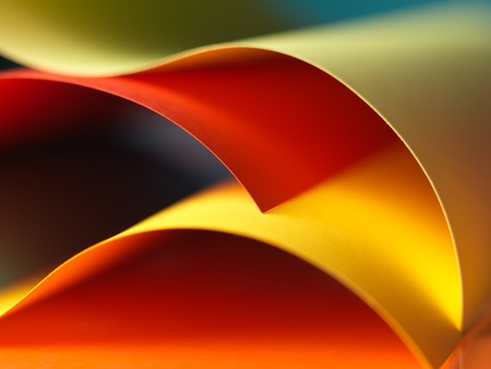 background macro image of colorful origami pattern made of curved sheets of paper photo
