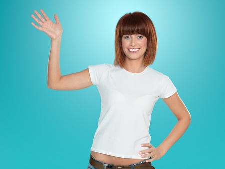 beautiful, young woman, smiling and waving her hand, on blue background photo