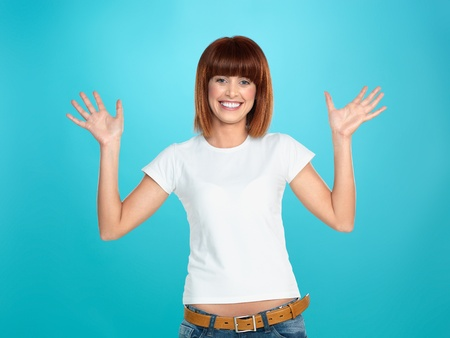 beautiful, young woman, smiling and waving her hands, on blue background Stock Photo - 13239887