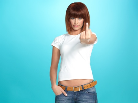 ugly woman: beautiful, young woman showing the middle finger, on blue background