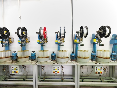 factory machine: detail of an indoor industrial production line, in a thread factory