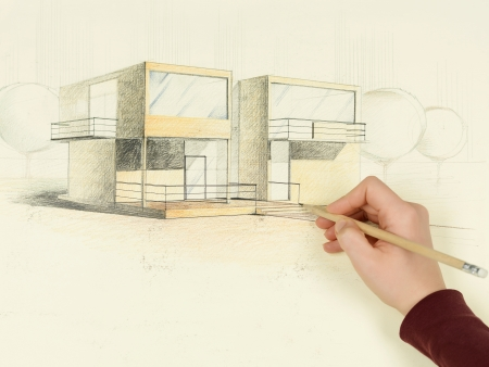 architect drawing: womans hand drawing architectural perspective of modern house