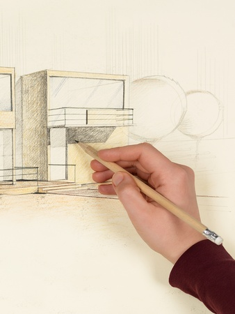 womans hand drawing architectural perspective of modern house photo