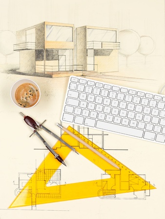 architectural blueprint of modern house, with computer keyboard, coffee cup, square and compasses photo