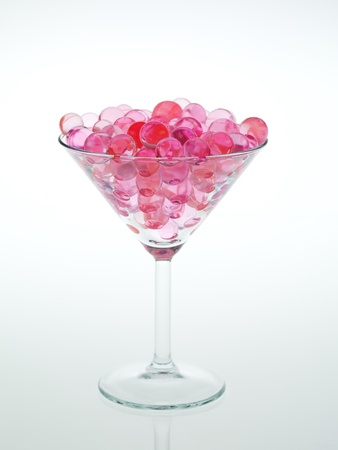 transparent pink glass beads with white background photo