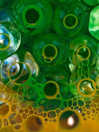 ball transparent liquid with yellow pigment and green Stock Photo - 14181549