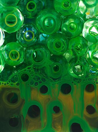 ball transparent liquid with yellow pigment and green photo