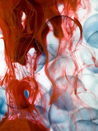 dispersed: cells with blue border transparent red paint dispersed in water