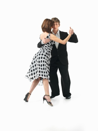 professional practice: young couple dancing argentinian tango, on white background