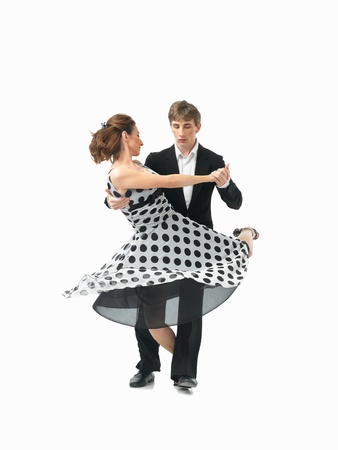 twirls: young couple dancing argentinian tango, on white background