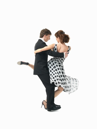 pirouette: young couple dancing argentinian tango, on white background