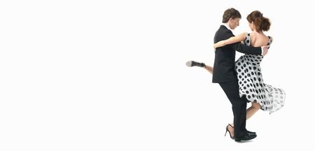 young couple dancing argentinian tango, on white background photo