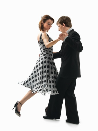 passionate, young couple dancing argentinian tango on white background photo