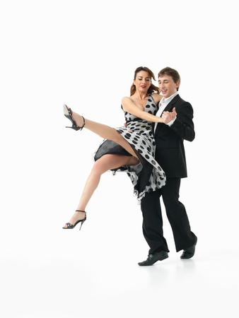 passionate, young couple showing interesting dance moves on white background photo