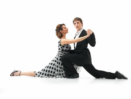 moves: passionate, young couple showing interesting dance moves on white background