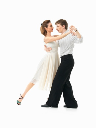passionate, young couple showing dance moves on white background Stock Photo - 14769175