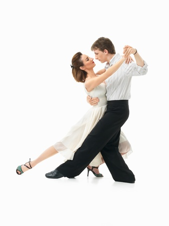 passionate, young couple showing dance moves on white background photo
