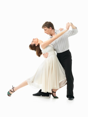 tango dance: passionate, young couple showing dance moves on white background Stock Photo