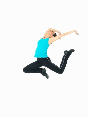 air demonstration: young woman in fitness outfit showing jumping moves on white background
