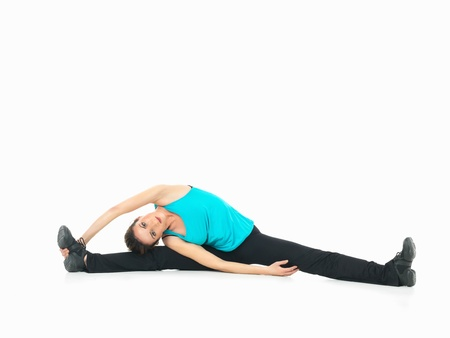 sexy, young woman showing fitness stretching moves on white background photo