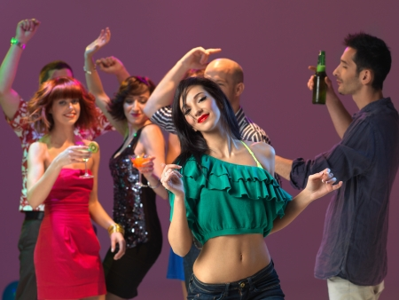disco girls: sexy, young woman dancing on the dancefloor, in a night club