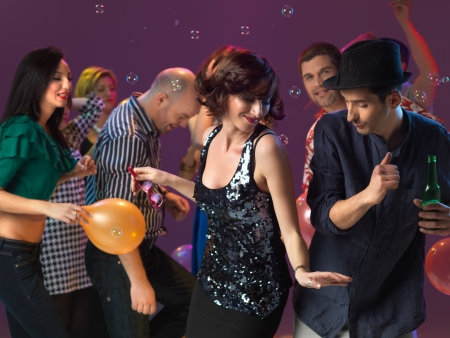 dj boy: happy, young couple flirting and dancing on the dancefloor in a night club