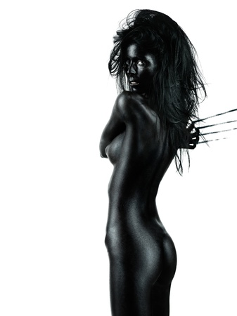 nude black women: artistic nude of a beautiful, young woman, with her back at the camera, looking over her shoulder, leaving scratch marks on the wall behind her