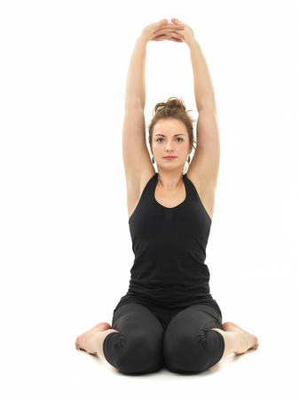 beautiful young woman sitting in hatha-yoga pose, on white background photo